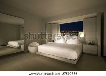 Hotel room with a bed in the middle and great view. - stock photo