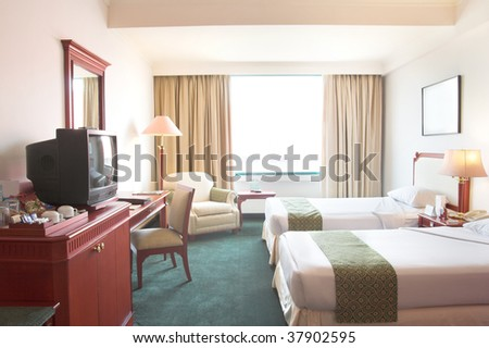 hotel room with CRT tv