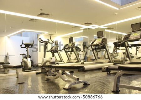 Hotel room with gym equipment - stock photo