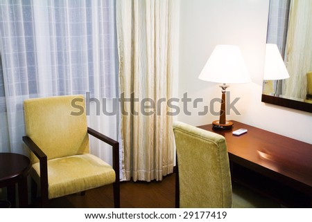 Hotel room with writing table - stock photo