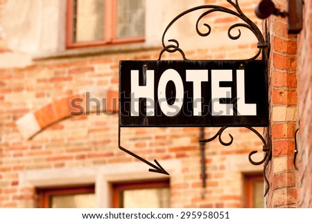 Hotel sign at the entrance of cozy accommodation in European city - stock photo