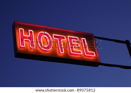 Hotel sign illuminated at night - stock photo