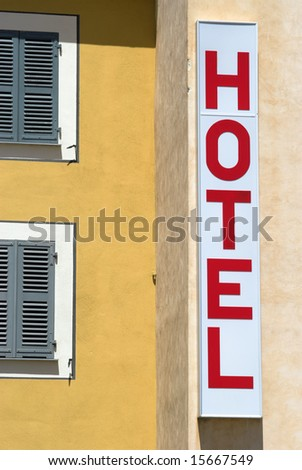 Hotel Sign on a Building - Outside a sunny day. - stock photo