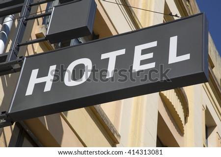Hotel Sign on Building Facade - stock photo