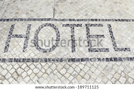 Hotel sign on floor, detail of an information signal at the entrance of a hotel - stock photo