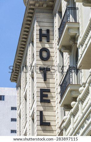 Hotel sign on stone facade of a classic building