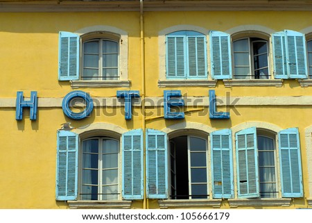 Hotel sign on the facade of hotel building exterior. Travel concept background  - stock photo