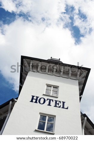 Hotel sign on white facade - stock photo