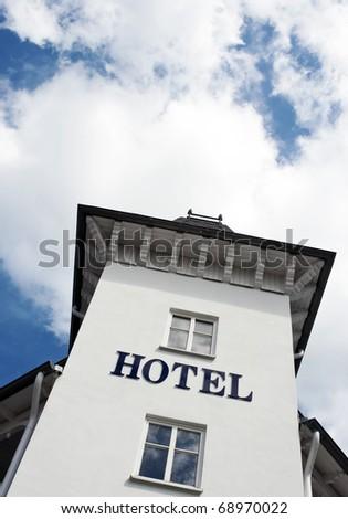 Hotel sign on white facade - stock photo