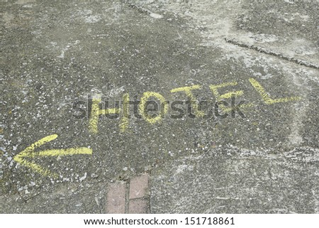 Hotel sign painted on the floor, indication and lodging - stock photo