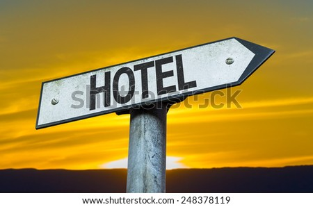 Hotel sign with a sunset background - stock photo
