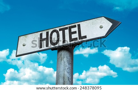 Hotel sign with sky background - stock photo