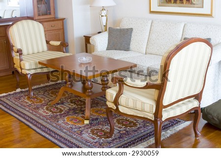 Hotel suite room showing the table and sofa - stock photo