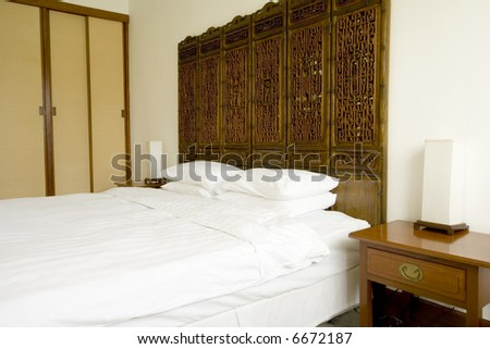 Hotel suite room with oriental styled decorations - stock photo