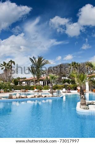 Hotel swimming pool - stock photo