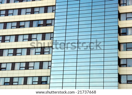 Hotel windows with a blue tinted glass - stock photo