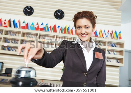 Hotel worker on reception - stock photo