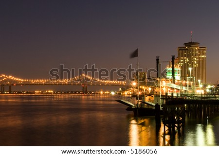 Hotels and bridge over Mississippi river at dusk - stock photo