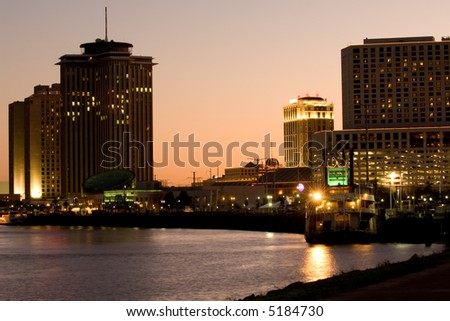 Hotels and casinos on Mississippi river at sunset - stock photo