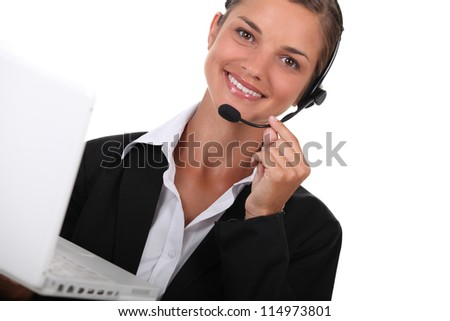 hotline operator with a computer - stock photo