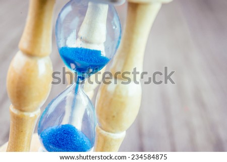 Hour glass on wooden background - vintage effect style pictures - stock photo