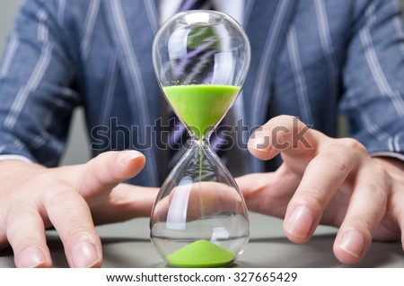Hourglass and businessman