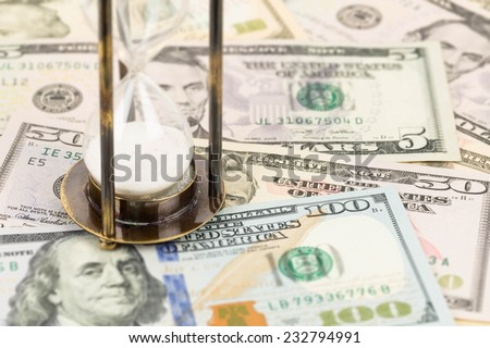Hourglass and dollar banknote concept for time value - stock photo