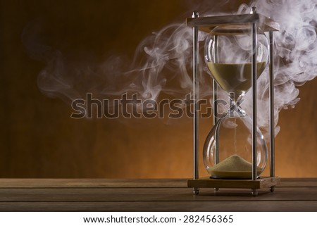 Hourglass and Mystic Smoke - stock photo