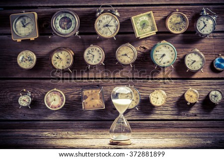 Hourglass as the old way of timing - stock photo