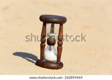 Hourglass on sand in desert  - stock photo