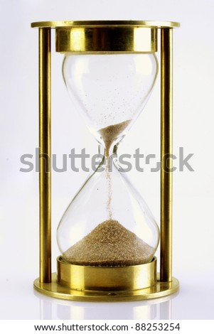 Hourglass on white - stock photo