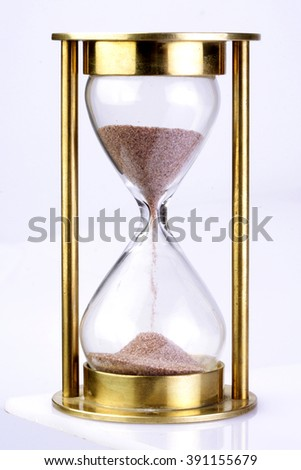 Hourglass on white background - stock photo