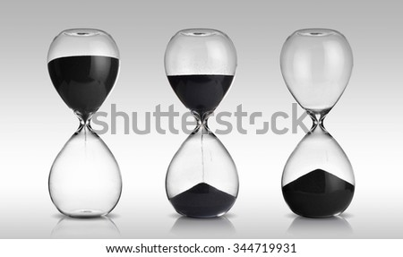 hourglass set on gray background - stock photo