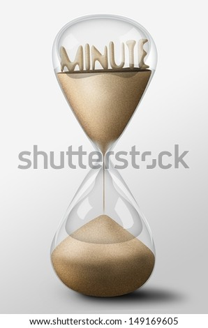 Hourglass with Minute word made of sand inside the clock. Concept of time passing