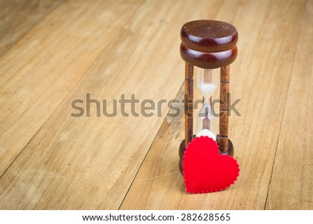 hourglass with red heart,infinity love,hourglass focus - stock photo