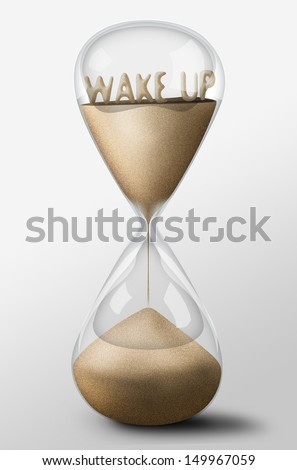 Hourglass with Wake Up word made of sand inside the clock. Concept of work