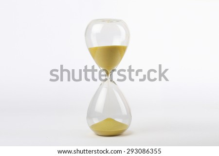 hourglass with yellow sand on white background - stock photo