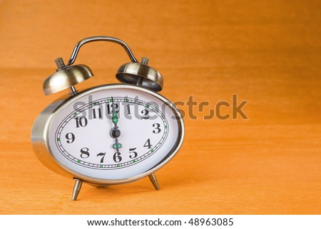 Hours an alarm clock on a color background