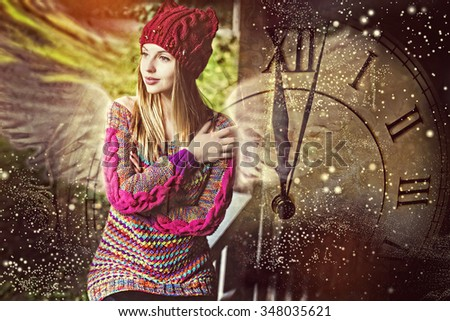 Hours show midnight, make the wish, the woman in a knitted cap - stock photo