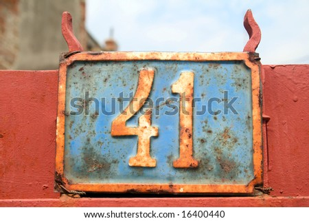 House address plate number 41 - stock photo