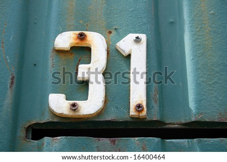House address plate number 31 - stock photo