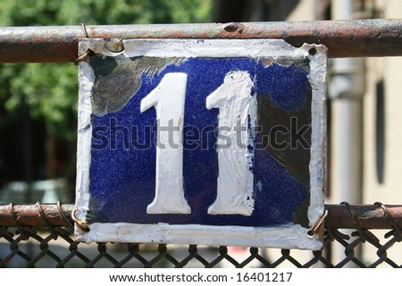 House address plate number 11 - stock photo