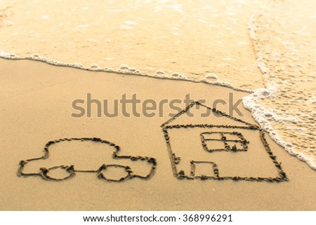 House and a Car drawing on the beach sand with the soft wave. - stock photo