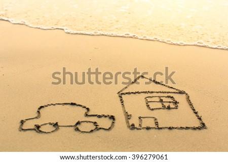 House and a car drawn on the sea beach. - stock photo