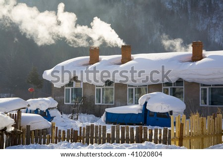 house and a truck were covered with heavy snow - stock photo