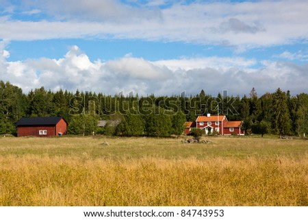 House and barn in a Swedish rural landscape. - stock photo