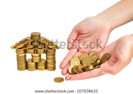 house and bunch coins in women hand isolated on white background