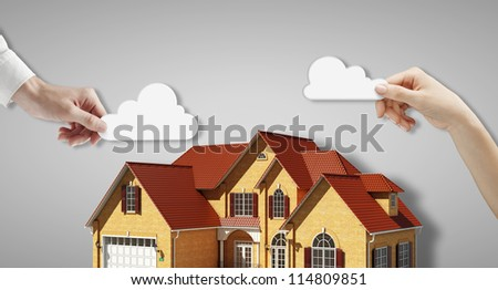 house and cloud in hands