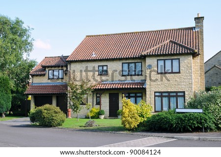 House and Garden on a Typical English Residential Estate - stock photo