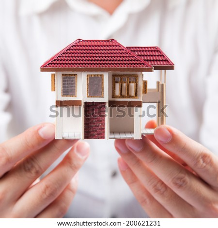 House and hands  - stock photo